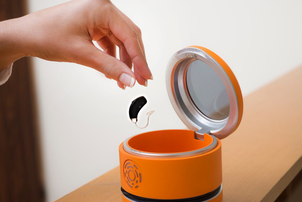 NEST wireless charging station for hearing aids